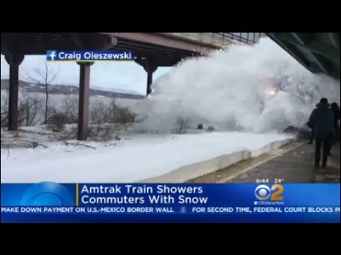 Amtrak Train Showers Commuters With Snow