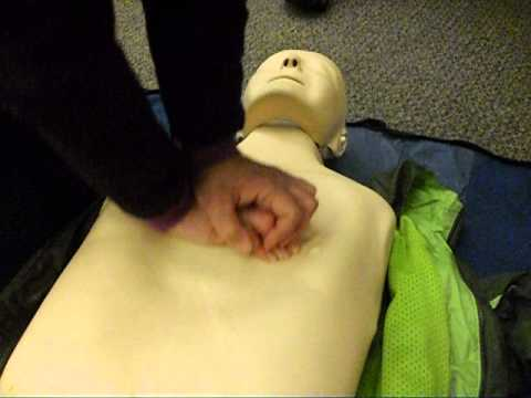 Chest compressions on a CPR dummy