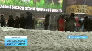 Crowds Make Best Of Snow: Blizzard provides winter wonderland in New York City