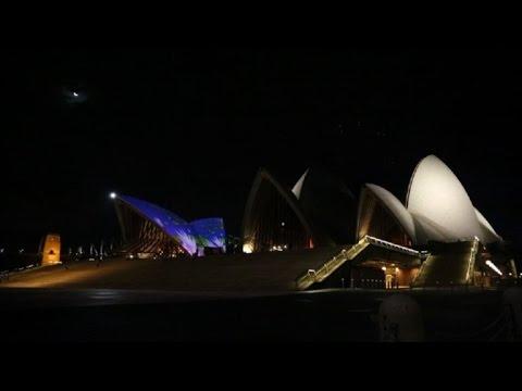 Sydney opera house lights up in honour of aboriginal art