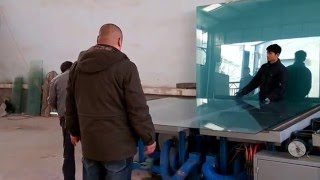three arms glass cutting table in one customer's factory