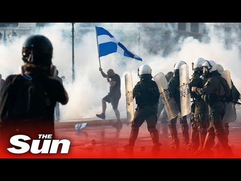 Police fire tear gas & water cannon anti-vax protesters in Greece