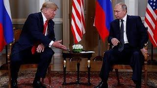 Watch: Trump and Putin shake hands