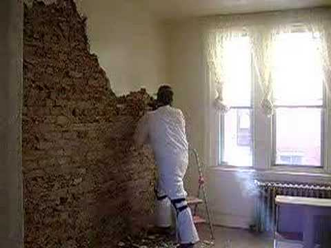 Removing plaster and exposing brick in a South Philly ...