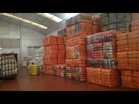 Wholesale containers of used clothing in bales
