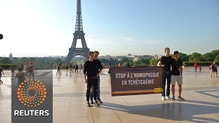 Amnesty protests against homophobia in Paris ahead of Putin visit