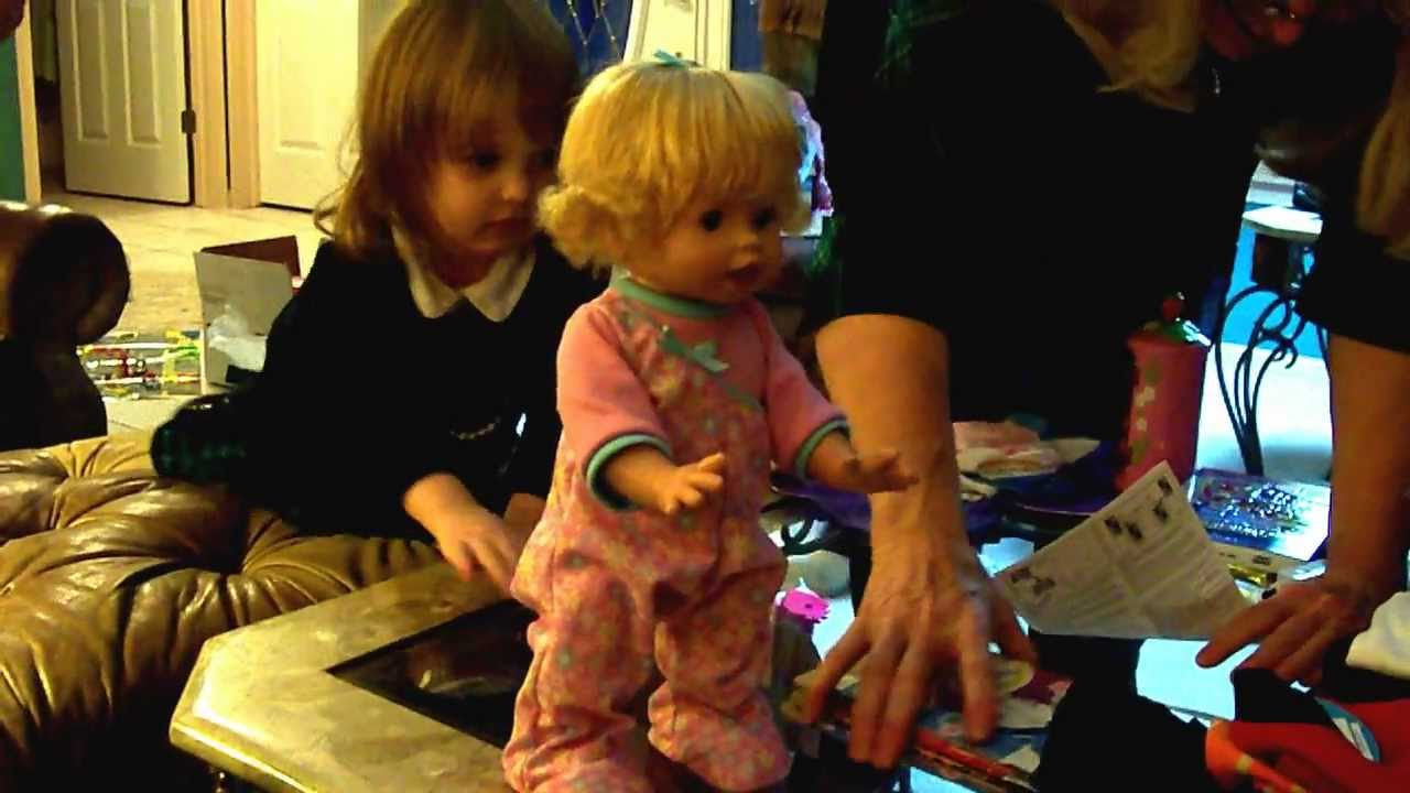 Toddler With A New Baby Doll That Can Walk Talk And Sit