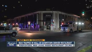 Man secretly living above Denver restaurant falls through ceiling(Man had to be cut out of the wall by fire crews. 12.10.14 5 a.m.., 2014-12-10T12:35:27.000Z)