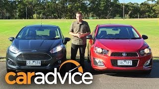 Holden Barina RS v Ford Fiesta Sport video review(Ford v Holden takes on a new meaning in this sporty hatchback battle. Read our head to head: ..., 2014-03-10T02:09:22.000Z)