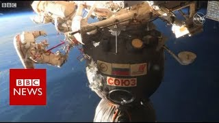 Samples cut around Soyuz hole in spacewalk - BBC News