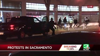 Caught on camera: Looters flee as armed officers drive up to Sacramento store