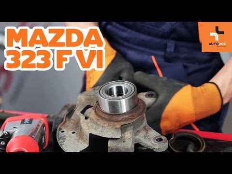 How to replace a front wheel bearing on MAZDA 323 TUTORIAL | AUTODOC