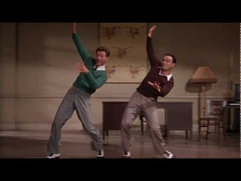 """Donald O'Connor and Gene Kelly in a dancing scene from """"Singin' In The Rain"""" movie"""