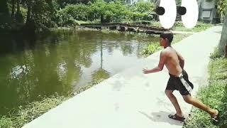 10 year  boy beautifully dive In a pond in slow motion(10 বছরের বালক পুকুরে ধীর গতিতে সুন্দর ঝাঁপ)
