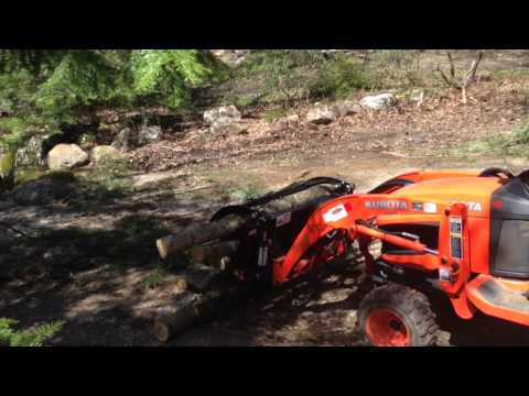 how to clear land with backhoe