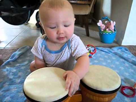 Baby beating drums