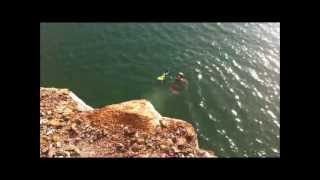 BMX Cliff Jumps Into Water