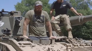Players Ride In Tanks, Helicopters With Military Members