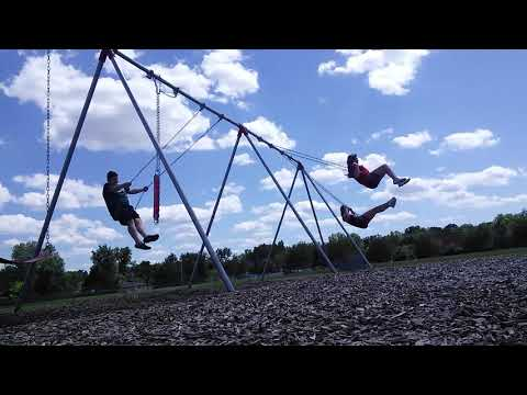 Joey Nina Megan are going higher on the swing in the playground at trautwein elementary School