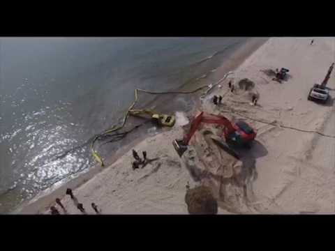 Grand Haven beach reopens after backhoe, bulldozer slide into lake