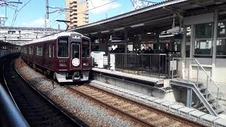 阪急電車十三駅で9000系(さくらヘッドマーク)急行大阪梅田行き発車シーン(2020年3月23日月曜日)携帯電話で撮影
