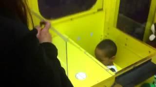 Kid climbs into claw machine