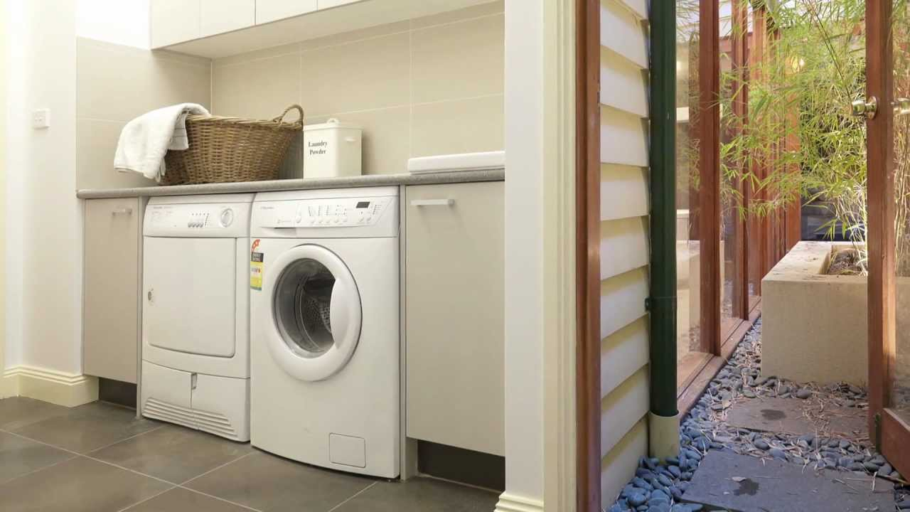 modern laundry design has changed significantly from the small