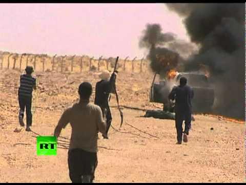 Dramatic video shows Libya rebels fighting 'Gaddafi loyalists'