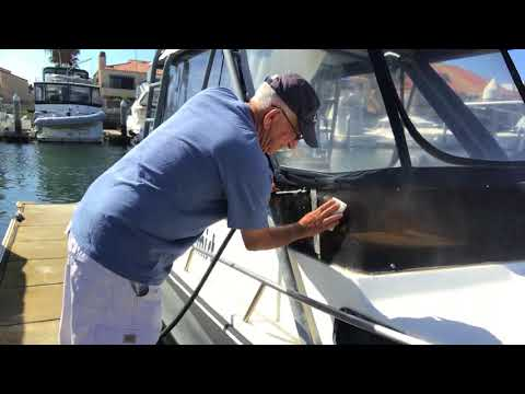 Downsail  Crazy Ron uses magic eraser on boat window. What would Mr Clean say?