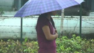 TRIBAL  GIRL  WAITING IN RAINFALL , ARUNACHAL  PRADESH , TIBETAN