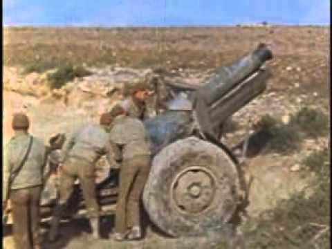 Firing 155mm Howitzer at Medjz El Bab, Tunisia, North Africa; Aftermath of Bombing, Lt Gen Eisen...
