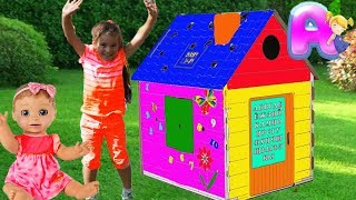 Anna play with funny toys | Build and Paints Colorful Playhouse for kids