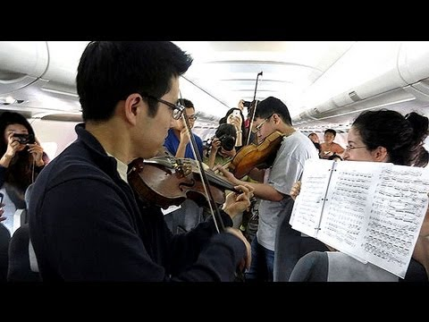 Orchestra performs concert on delayed plane in Beijing