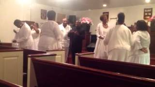 The New Community Gospel Choir( Singing Tell It Sung By Christina Robinson-Rogers)
