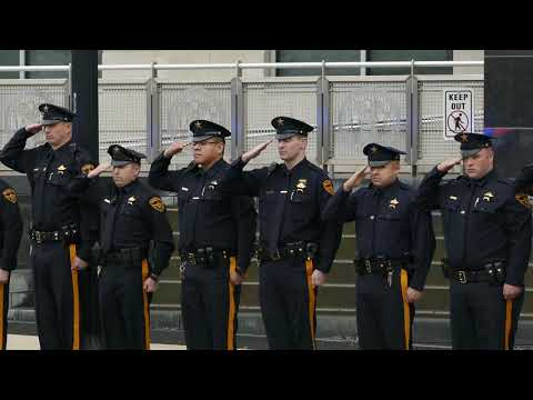 Funeral motorcade for fallen officer drives by courthouse