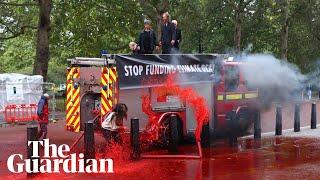 Fake blood sprayed on Treasury in Extinction Rebellion protest