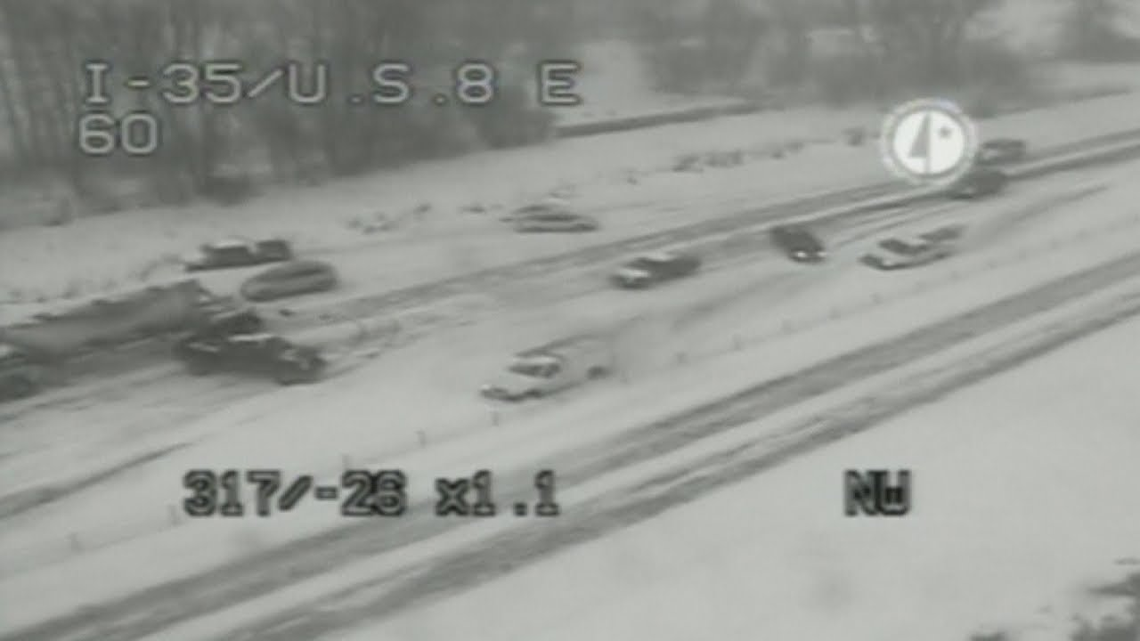Caught on camera: Multiple car crashes shut main highway after heavy snow  during rush hour in USA