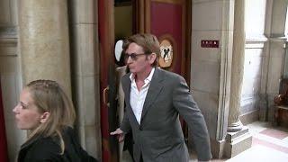 Benoit Magimel leaving court in Paris