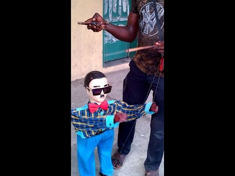 A Puppet dancing to TeKno's Monica Lover Lover Music