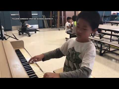 Fifth grader takes recess to play piano for first-graders