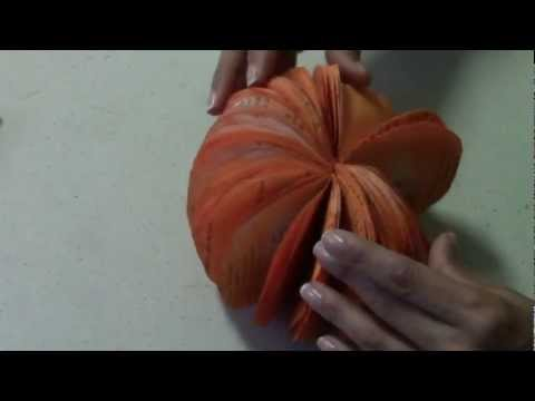 How to make a pumpkin from recycled paper.