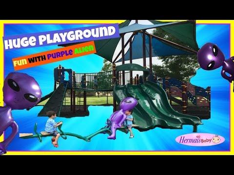 huge-outdoor-park-playground-for-children-giant-seesaw,-monkey-bar,-swing,-slide-purple-alien