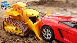 Car toys in the dirt. Playing out dirt with a bulldozer. Wash car and sand play.