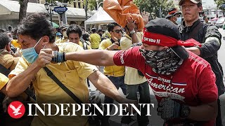 Republican and pro-monarchy protesters throw punches and launch bottles in Thailand