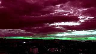 Red clouds and green sunset. Красные облака.