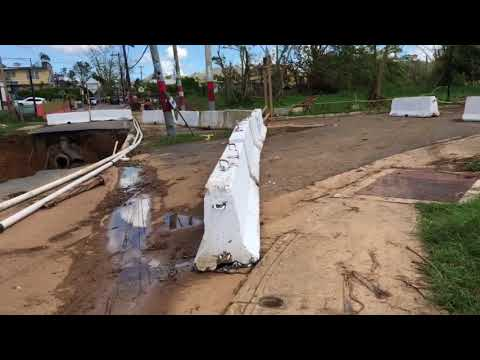 Massive hole in road at Añasco, Puerto Rico after flooding from Hurricane Maria