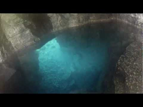 Exploring the Grotto: Cave around the left bend, pool inside!