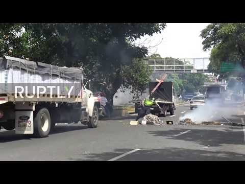 Venezuela: Molotov cocktails fly as police and protesters clash in Caracas