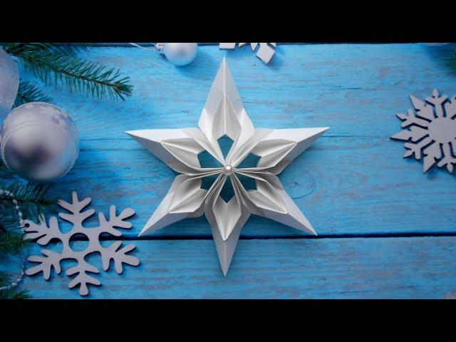 Смотреть видео Снежинка из бумаги  Новогодние поделки оригами