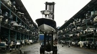 AWESOME BOAT FORK LIFT PUTTING BOATS IN WATER FROM A THREE STORY STORAGE UNIT ON THE COAST